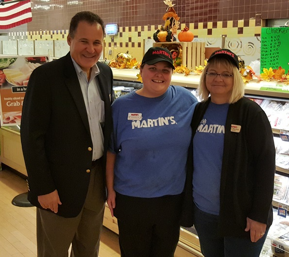 June Associate Of The Month Angie Painter And Deli Manager Stella Morton Welcome Division President Tom Lenkevich To The Charles Town, WV, Martin's