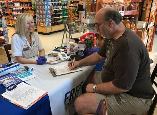 Mary Of The Eldersburg, MD, Martin's Pharmacy Providing A Health Screening To Customers