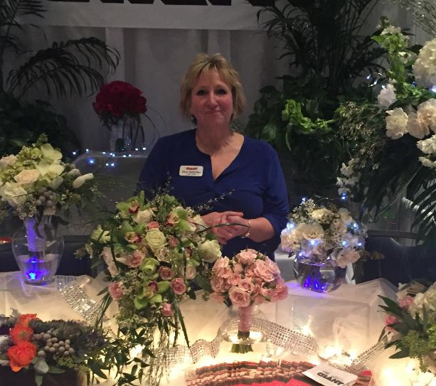 Floral Lead Alice Mulhollan Of Store 6072 At The Central PA Bridal Show In State College