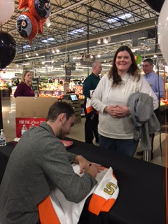 Deli Manager Jenn Behrle Getting An Autograph From NHL Player Shayne Gostisbehere