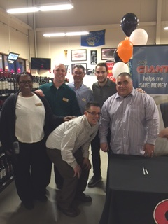 The Store Management Team Of Store #6534 With NHL Player Shayne Gostisbehere