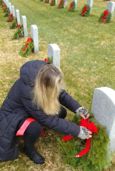 A Volunteer Places A Wreath To Honor A Fallen Hero